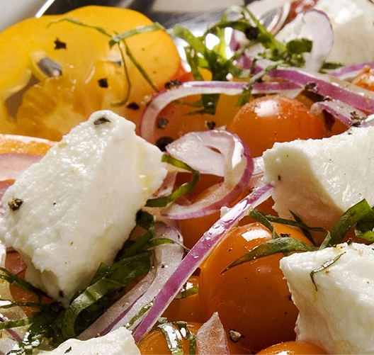 Heirloom-Tomato-Salad-with-Thyme-Rosemary-Marinated-Goat-Cheese_021219